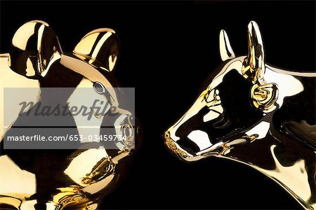 A Gold Pig And A Gold Bull Stock Photo - Premium Royalty-Free, Image code: 653-03459734