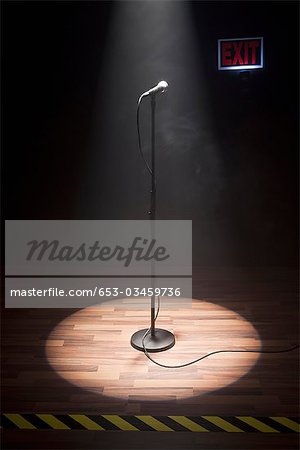 A Microphone Illuminated On A Stage Stock Photo - Premium Royalty-Free, Image code: 653-03459736