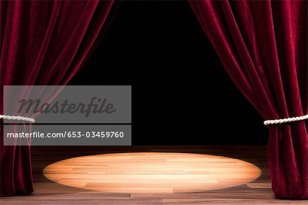 A Spot Lit Empty Theatre Stage Stock Photo - Premium Royalty-Free, Image code: 653-03459760