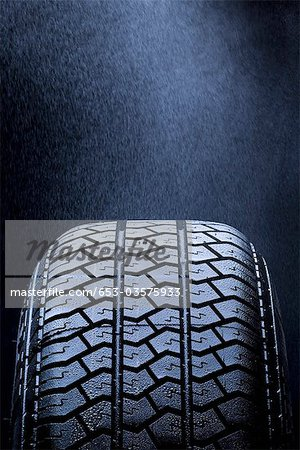 Detail of mist falling on a car tire Stock Photo - Premium Royalty-Free, Image code: 653-03575933