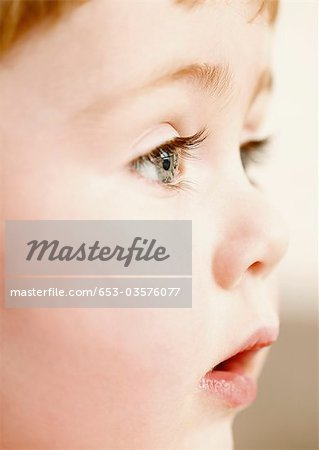Close-up of a young boy looking away Stock Photo - Premium Royalty-Free, Image code: 653-03576077