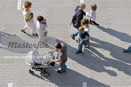A group of people walking through a parking lot Stock Photo - Premium Royalty-Free, Image code: 653-03613223