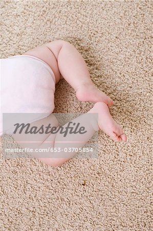 Waist down of a baby Stock Photo - Premium Royalty-Free, Image code: 653-03705854