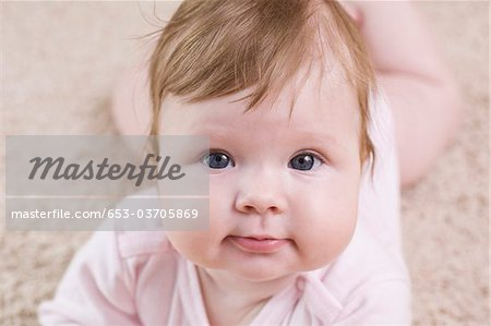 A baby looking at camera, portrait Stock Photo - Premium Royalty-Free, Image code: 653-03705869