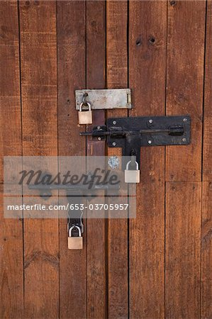 Detail of bolted locks on a wooden door Stock Photo - Premium Royalty-Free, Image code: 653-03705957
