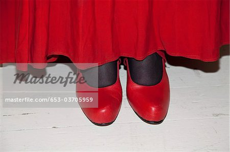 Detail of a woman wearing a red skirt and red shoes Stock Photo - Premium Royalty-Free, Image code: 653-03705959