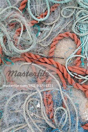 Detail of ropes and fishing nets on the ground Stock Photo - Premium Royalty-Free, Image code: 653-03706321