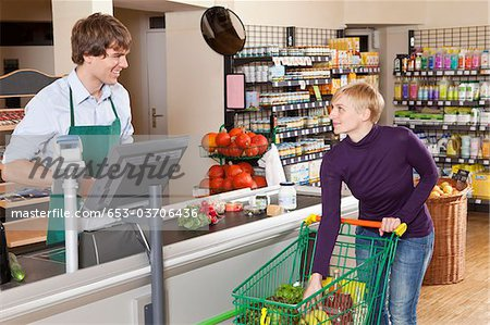 A customer checking out in a supermarket Stock Photo - Premium Royalty-Free, Image code: 653-03706436
