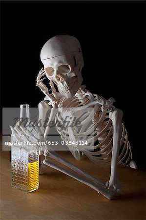 An alcoholic skeleton Stock Photo - Premium Royalty-Free, Image code: 653-03843114