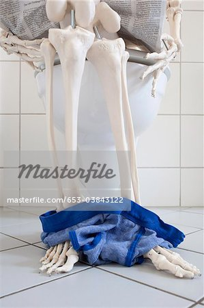 A skeleton using a toilet, low section Stock Photo - Premium Royalty-Free, Image code: 653-03843122