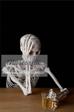 An alcoholic skeleton Stock Photo - Premium Royalty-Free, Image code: 653-03843137