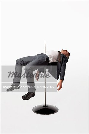 A businessman impaled on a spindle Stock Photo - Premium Royalty-Free, Image code: 653-03843145