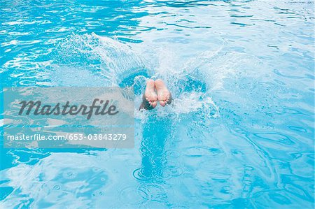 Detail of a boy diving into a swimming pool Stock Photo - Premium Royalty-Free, Image code: 653-03843279