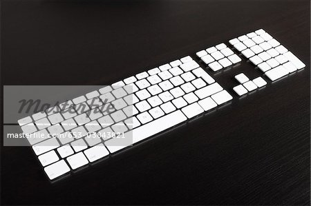 Separate computer keys arranged to look like an actual keyboard Stock Photo - Premium Royalty-Free, Image code: 653-03843821
