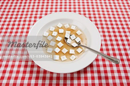 A bowl of soup with various computer keys floating in it Stock Photo - Premium Royalty-Free, Image code: 653-03843841