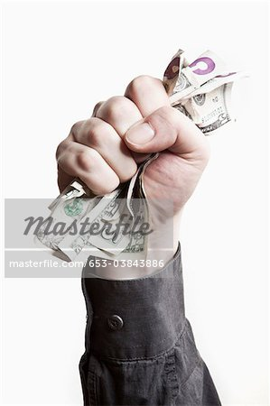 A man gripping a wad of US paper currency, close-up of hand Stock Photo - Premium Royalty-Free, Image code: 653-03843886