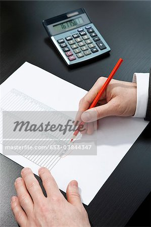 Invoice totaling Stock Photo - Premium Royalty-Free, Image code: 653-03844347