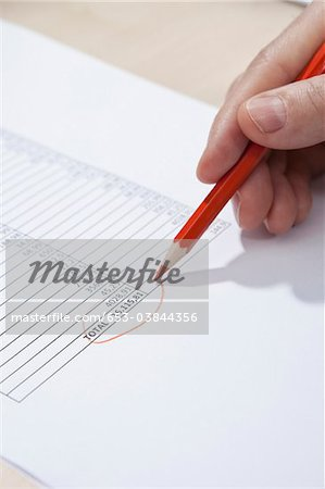 Invoice totaling Stock Photo - Premium Royalty-Free, Image code: 653-03844356
