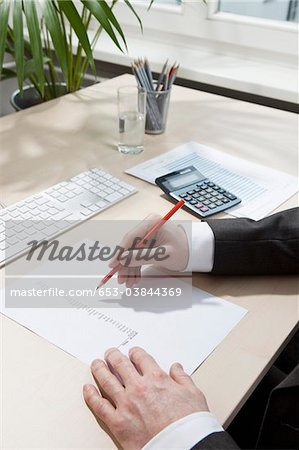 Invoice totaling Stock Photo - Premium Royalty-Free, Image code: 653-03844369