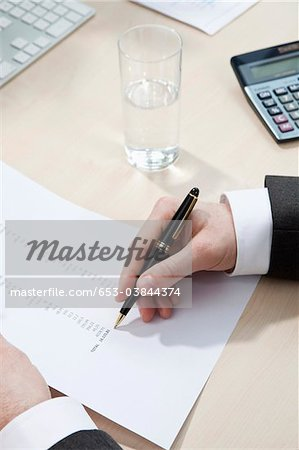Invoice totaling Stock Photo - Premium Royalty-Free, Image code: 653-03844374