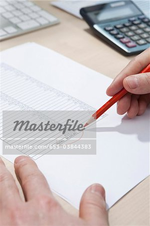 Invoice totaling Stock Photo - Premium Royalty-Free, Image code: 653-03844383