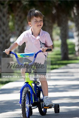 A boy riding a bike Stock Photo - Premium Royalty-Free, Image code: 653-05393038