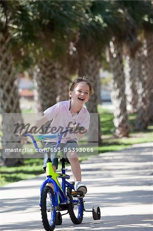A boy riding a bike Stock Photo - Premium Royalty-Free, Image code: 653-05393066