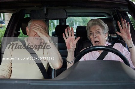 Senior woman having trouble learning to drive as man in passenger seat despairs Stock Photo - Premium Royalty-Free, Image code: 653-05393393
