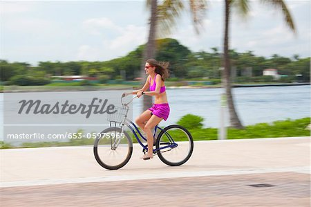 Girl cycling barefoot Stock Photo - Premium Royalty-Free, Image code: 653-05975969