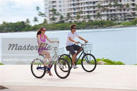 Girl and boy cycling on promenade Stock Photo - Premium Royalty-Free, Image code: 653-05975973