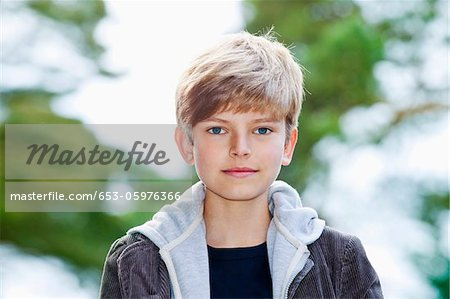 Portrait of a serious adolescent boy Stock Photo - Premium Royalty-Free, Image code: 653-05976366