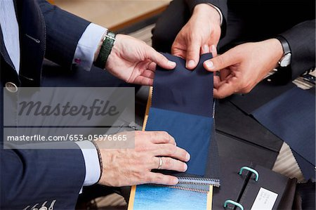 Detail of two men holding fabric samples Stock Photo - Premium Royalty-Free, Image code: 653-05976665