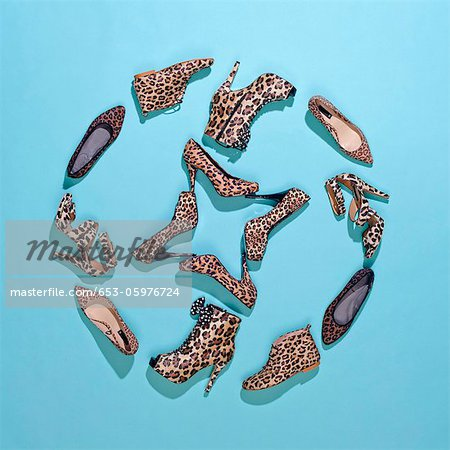 Various leopard print shoes arranged in a pattern Stock Photo - Premium Royalty-Free, Image code: 653-05976724