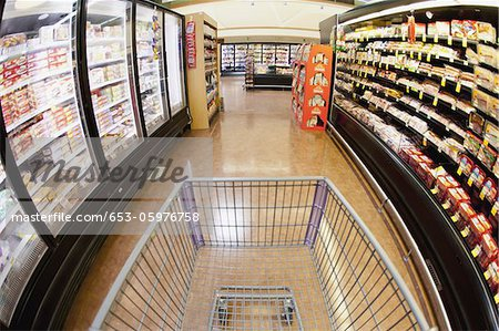 A shopping cart on an aisle in a supermarket, personal perspective Stock Photo - Premium Royalty-Free, Image code: 653-05976758