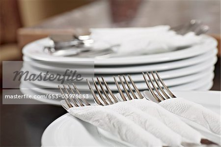 Forks and knives wrapped in paper napkins Stock Photo - Premium Royalty-Free, Image code: 653-05976863