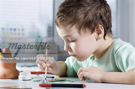 Boy Painting in workshop Stock Photo - Premium Royalty-Free, Image code: 653-05976879