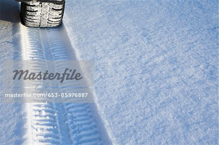 Tyre track on snow Stock Photo - Premium Royalty-Free, Image code: 653-05976887