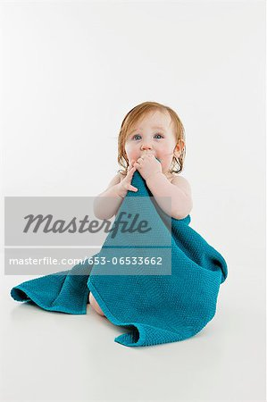 A baby girl wrapped in a towel Stock Photo - Premium Royalty-Free, Image code: 653-06533662