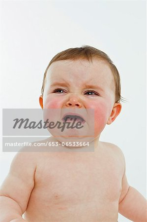 A baby girl crying Stock Photo - Premium Royalty-Free, Image code: 653-06533664
