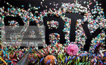 The word PARTY stenciled in confetti Stock Photo - Premium Royalty-Free, Image code: 653-06533855