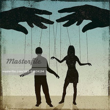 A silhouetted man and woman being controlled by a puppeteer Stock Photo - Premium Royalty-Free, Image code: 653-06534194