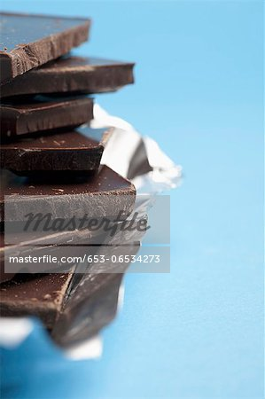 Detail of a stack of dark chocolate Stock Photo - Premium Royalty-Free, Image code: 653-06534273