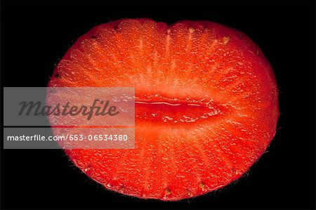 A suggestively shaped cross section of a strawberry Stock Photo - Premium Royalty-Free, Image code: 653-06534380
