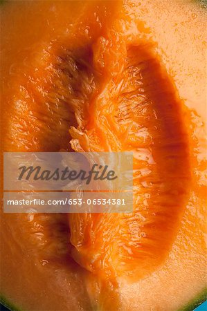 A juicy slice of cantaloupe that is suggestive of female genitalia Stock Photo - Premium Royalty-Free, Image code: 653-06534381
