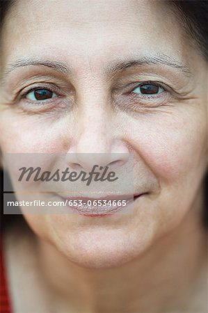 A mature woman looking tranquil, close-up Stock Photo - Premium Royalty-Free, Image code: 653-06534665
