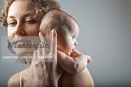 Mother holding her daughter Stock Photo - Premium Royalty-Free, Image code: 653-06819469