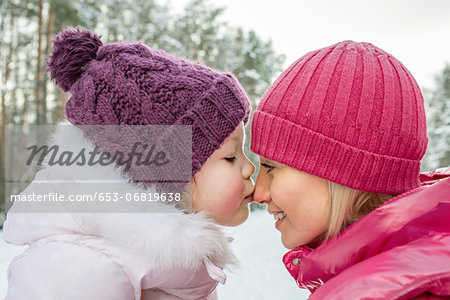 A mother and daughter wearing warm clothing, outdoors, face to face Stock Photo - Premium Royalty-Free, Image code: 653-06819638