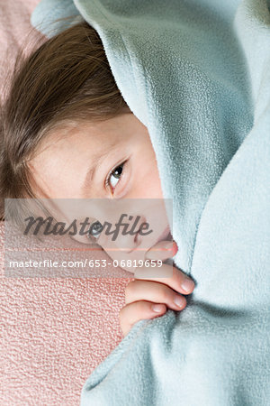 Girl under blanket Stock Photo - Premium Royalty-Free, Image code: 653-06819659