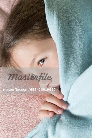 Girl under blanket Stock Photo - Premium Royalty-Free, Image code: 653-06819680