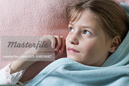 Daydreaming girl under blanket Stock Photo - Premium Royalty-Free, Image code: 653-06819687